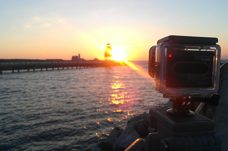 Future Media recording a timelapse of the sun setting on Lake Michigan in Charlevoix Michigan.