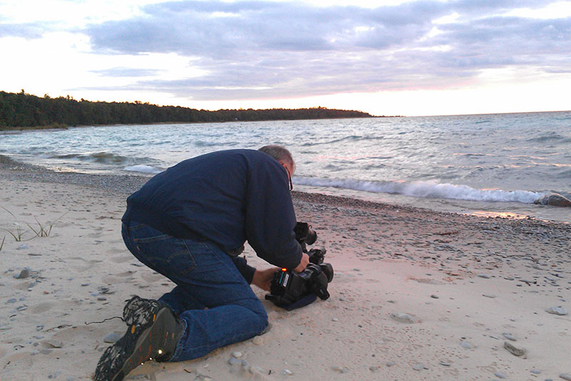 Future Media's Bob Bishop shoots b-roll down by Lake Michigan in Charlevoix for Land Swap video.