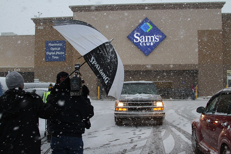 Future Media shooting video footage in snow storm outside Sam's Club in Lansing Michigan.