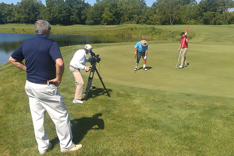 Future Media video crew shooting footage for Springer Prosthetics' video on golf course.