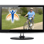 "Video monitor with Springer Prosthetics ""Let's Roll"" image, woman riding bike on rural street."